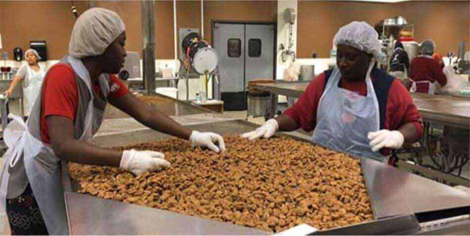 Praline pecans are carefully sorted in our Alabama Kitchen