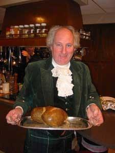 Andrew Hamilton holding a presentation haggis on a serving tray