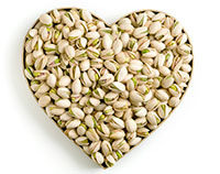 Pistachios arranged in the shape of a heart